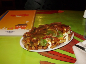 Poutine - A fast food dish -fries, cheese + gravy - said to have originated in Montreal